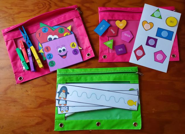Three laminated examples of preschool busy bags.