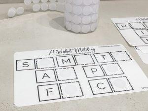 Adding velcro to Montessori alphabet matching sheets