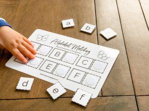 Alphabet matching little hand
