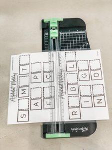 Cutting Montessori letter order in half sheets