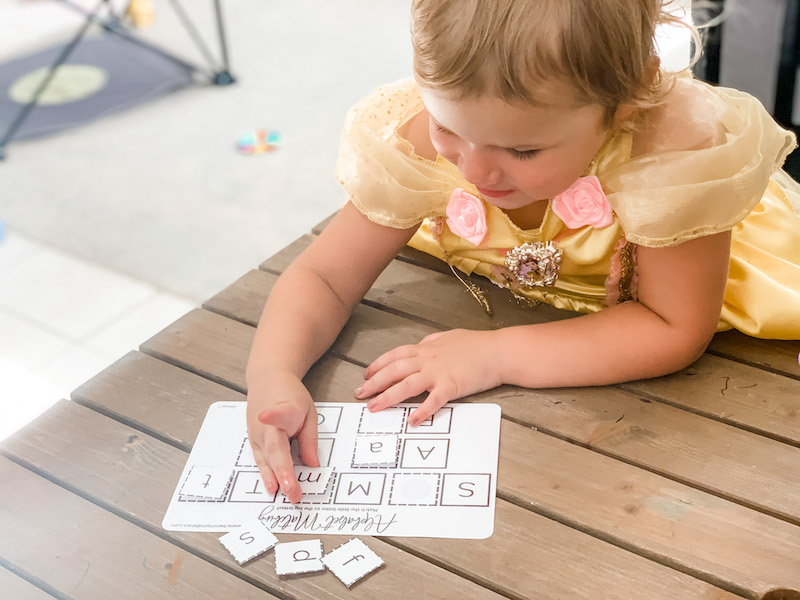 toddler playing with montessori alphabet matching